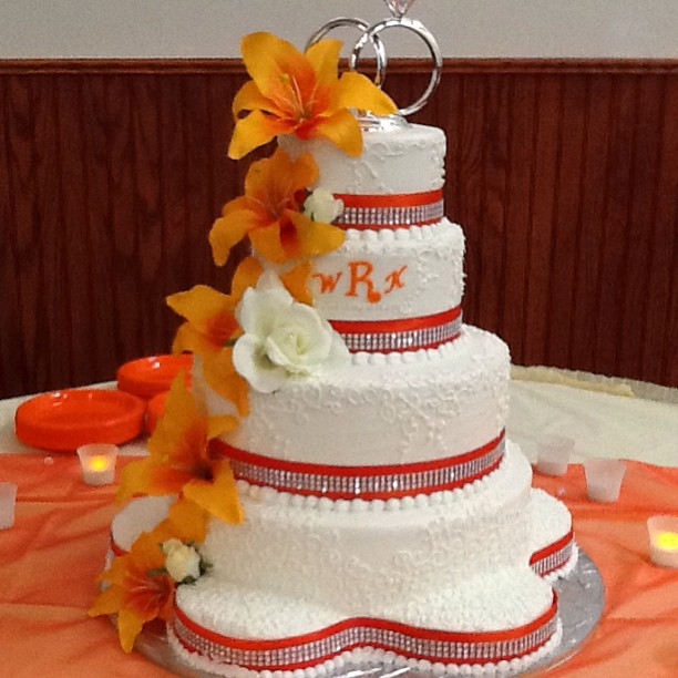 Orange and ivory 5 tiered wedding cake