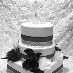 3 tiered black and white Wedding cake with glass bride and groom topper. Www.specialtysweetc