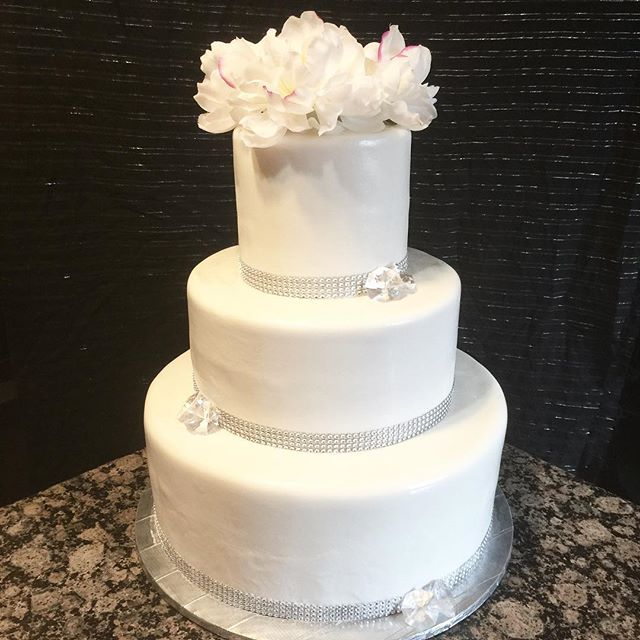 Instagram - 3 tiered white fondant wedding cake with rhinestone border. Www.Specialtysweetc