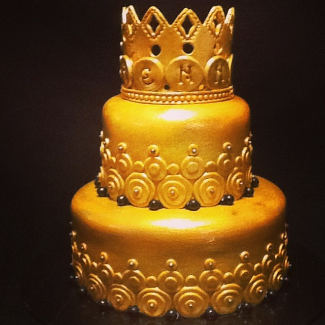 2 tier golden decorative crown cake. 614-218-7612