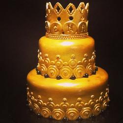 2 tier golden decorative crown cake. 614-218-7612