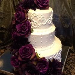 3 tiered wedding cake with silk purple flowers
