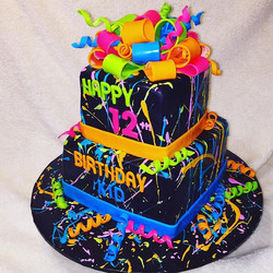 Two tiered square splatter paint neon colored birthday cake. Www.Specialtysweetc