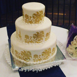 White and Gold 3 tiered Wedding Cake.