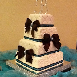 4 tiered choc and blue blinged wedding cake