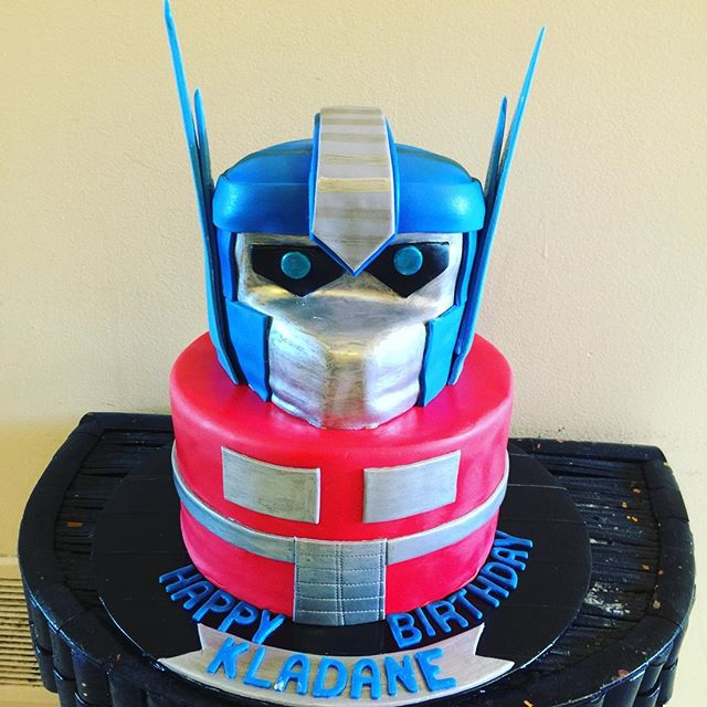 Optimus Prime Transformer 2 tiered Cake. Www.Specialtysweetc