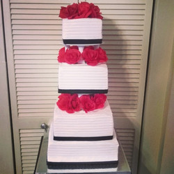 4 tier black, white and red rose wedding cake