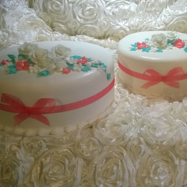 Fondant wedding cakes with handmade gumpaste edible flowers. Www.specialtysweetc