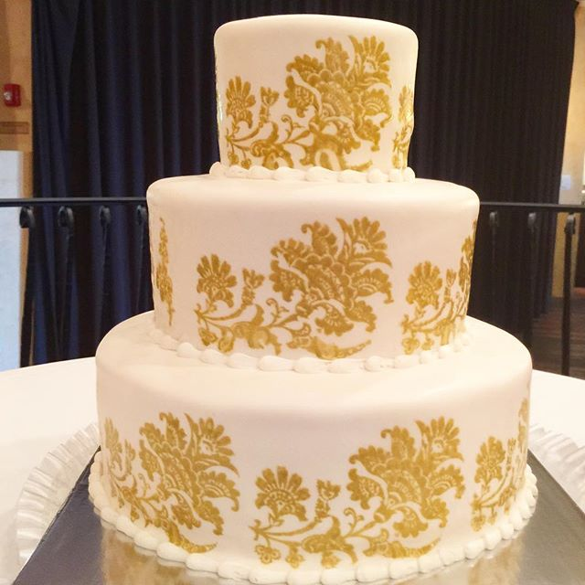 3 tiered white with gold stencil wedding cake