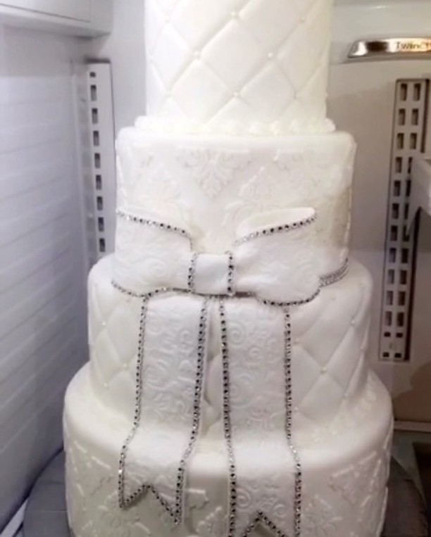 #specialtycakes #4tierweddingcake #fondantweddingcakes www.specialtysweetc