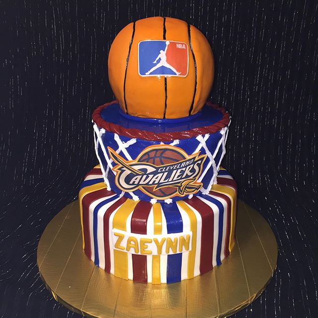 three-tiered Cleveland cavaliers cake. Www.Specialtysweetc