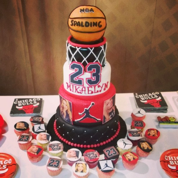 5 tier Jordan Themed Basketball cake and matching cupcakes.jpg  614-218-7612