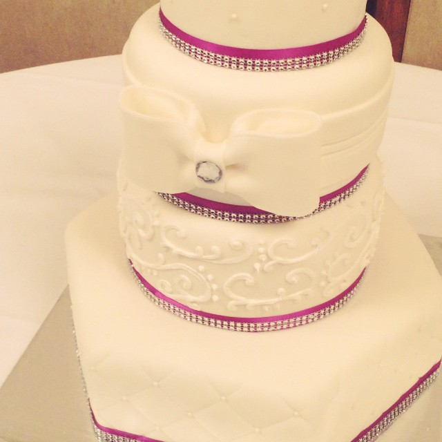 4 tier fondant designed wedding cake