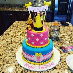 Two-tiered curious George birthday cake.  Www.Specialtysweetc
