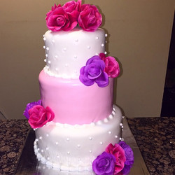 3 tiered cake. Pink, white and purple.