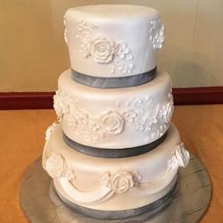 Fondant floral wedding cake. Www.Specialtysweetc
