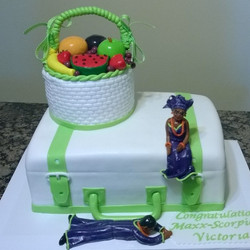 Nigerian wedding cake with hand made people. Www.specialtysweetc