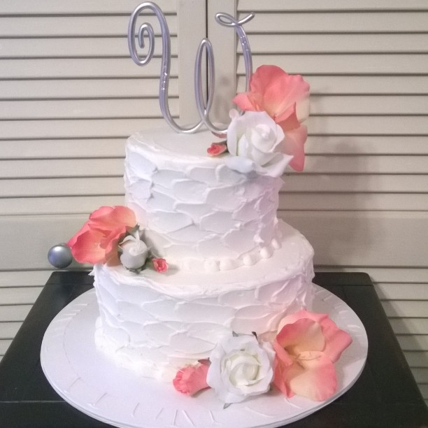 2 tiered iced wedding cake.