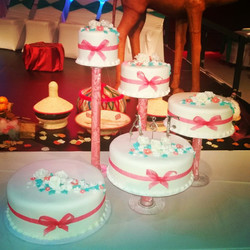 5 tiers fondant covered wedding cake with handmade gumpaste flowers. Www.specialtysweetc