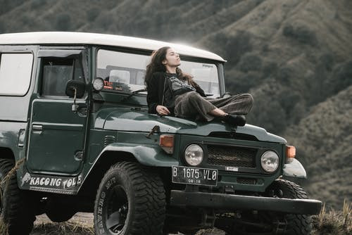 Woman lying on a jeep