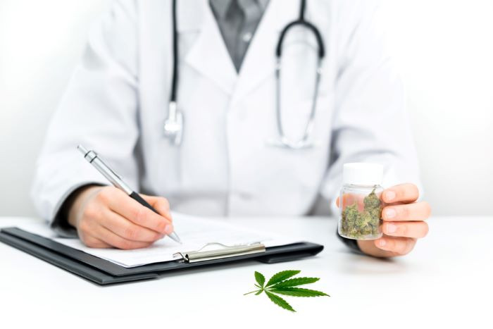 Doctor gives out a prescription for medicinal cannabis as a cure for pain