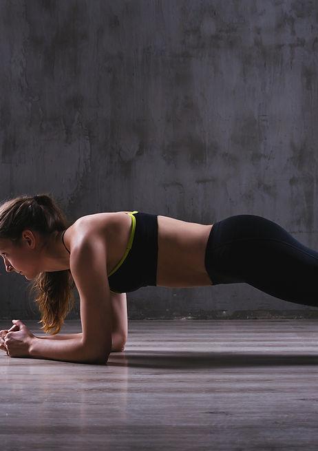Sport woman posing in photostudio. Fitne