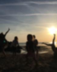 Kids dancing at sunset.jpg