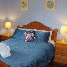 Main bedroom in Pardalote Cottage