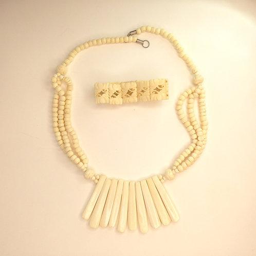 ivory coloured necklace and bangle set