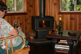 Relax by the fire at Bilyana Cottages