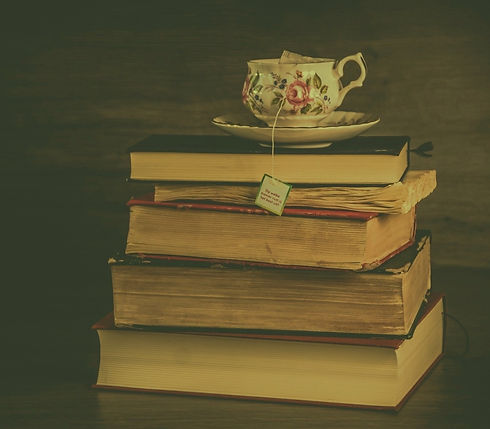 A cup of tea with some books