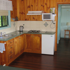 Kitchen area in Rosella Cottage