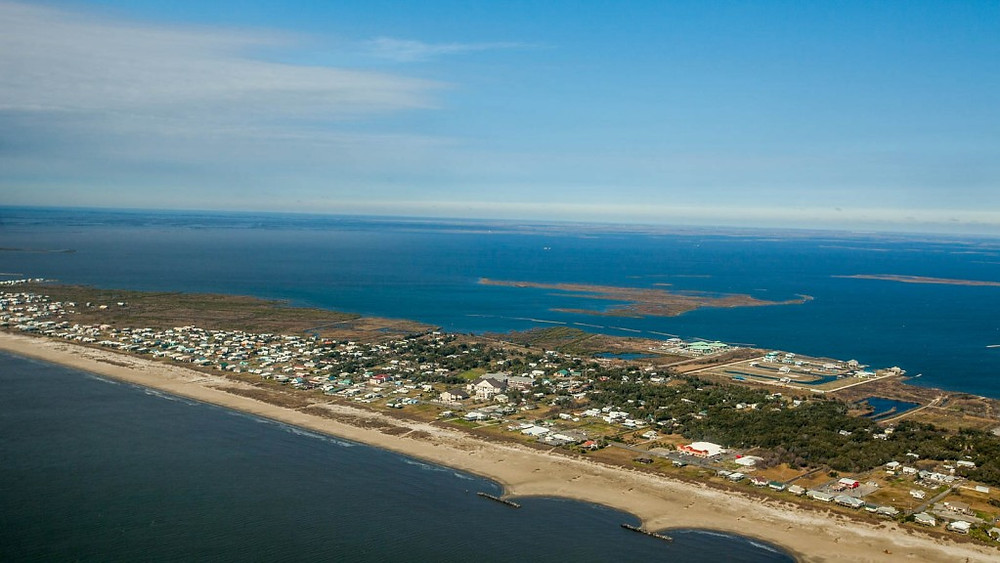 Aerial view of Grand Isle, a barrier island located in the Gulf of Mexico at the mouth of Barataria Bay in Louisiana.