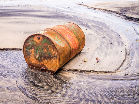 Rusty barrel oil on a partly black colou
