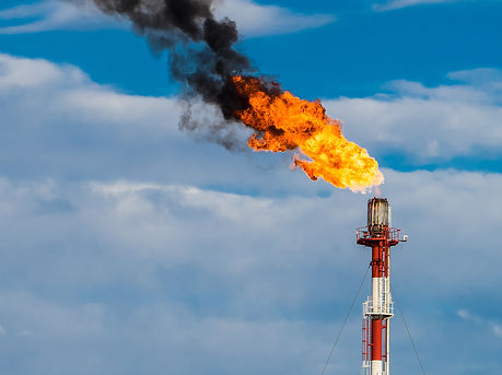 Refinery chimney with fire.jpg