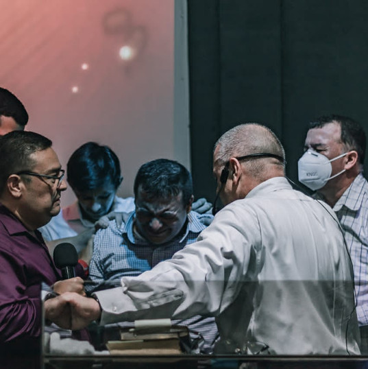 Leaders Praying over Ps Juan Carlos
