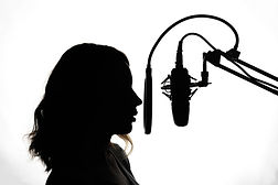 Silhouette of a girl with a studio micro