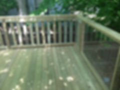 new deck with glass railing