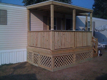deck with a roof by BEEZ Construction