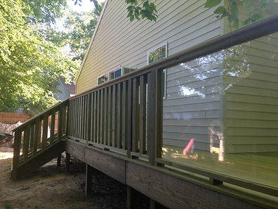new deck with wood and glass railing