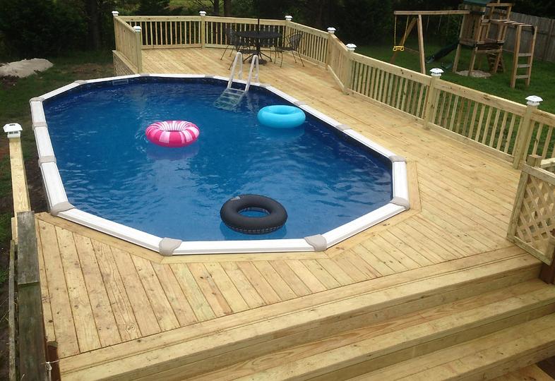 Custom Deck around pool by BEEZ Construction