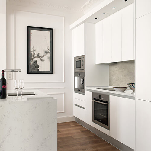 Cambria Quartz countertop, white kitchen, stainless steel built in appliances