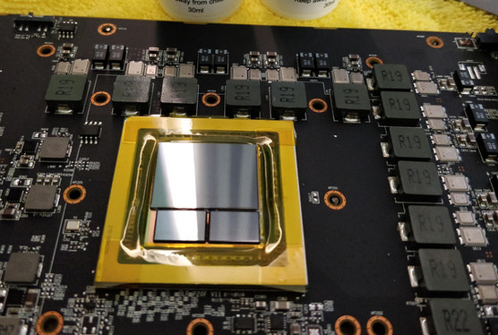 Vega 10 GPU package with protective tape around it (unmoulded HBM)