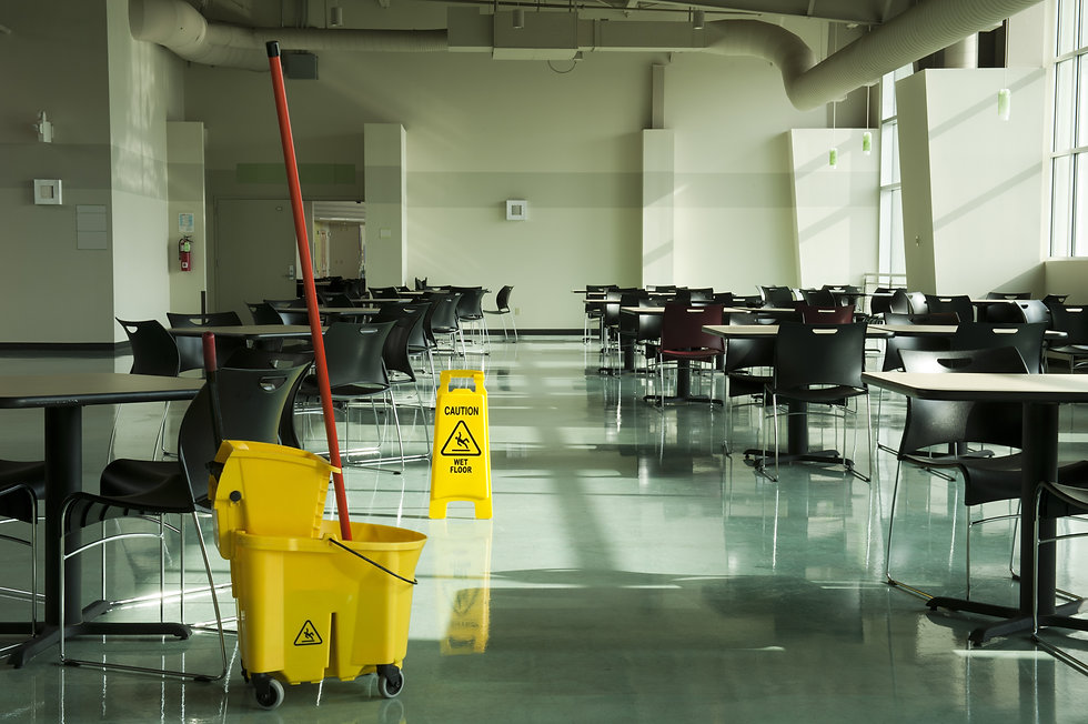 A mop, bucket and caution sign in a cafe