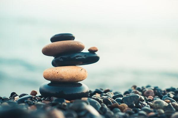 Stones pyramid on pebble beach symbolizi