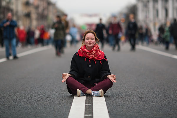 Cute girl sitting in meditation in the m