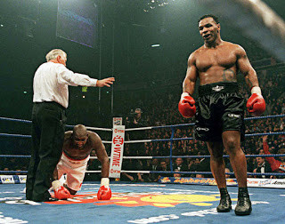 Tyson wins after knockdown No 5 over Julius Francis put the Londoner down again.