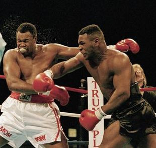 Larry Holmes ships a right hand