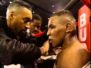 New trainer Aaron Snowell gives Tyson some advice between rounds