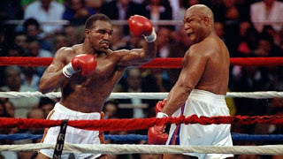 Holyfield nails Foreman with a left